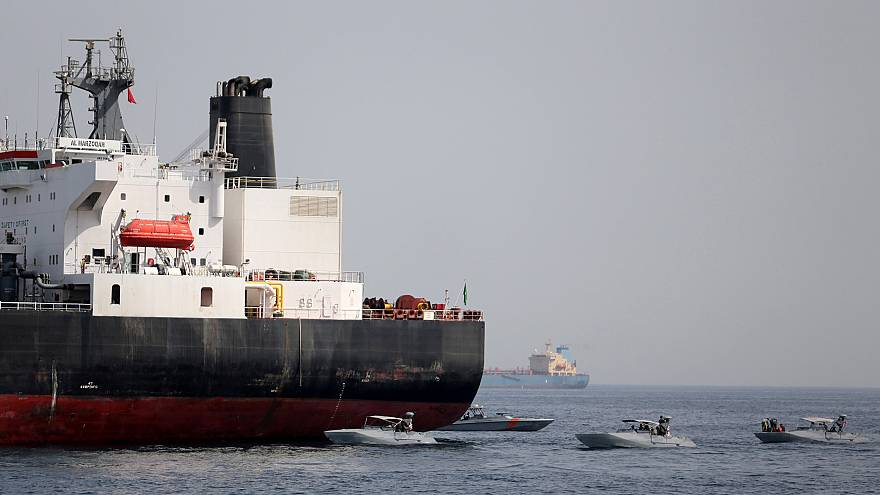 Image: UAE Navy boats are seen next to the Saudi tanker Al Marzoqah off the