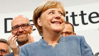 Merkel 12 yıllık koltuğunu kaptırmadı