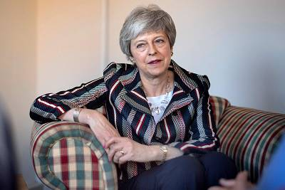 Britain\'s Prime Minister Theresa May visits a charity providing support for victims of domestic violence in west London on May 13, 2019.