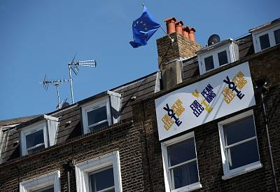 A European Union flag flies and a Vote European Election sign hangs from a house in south London, Britain, May 16, 2019.