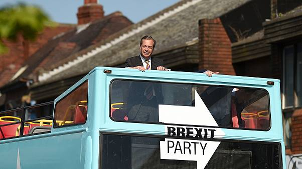 Image: Brexit Party leader Nigel Farage rides on their bus during a visit c