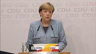 Merkel kündigt Gespräche mit FDP, Grünen und SPD an