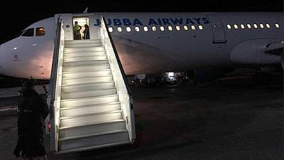 Somalis cheer first night landing of plane at Mogadishu airport in 27 years