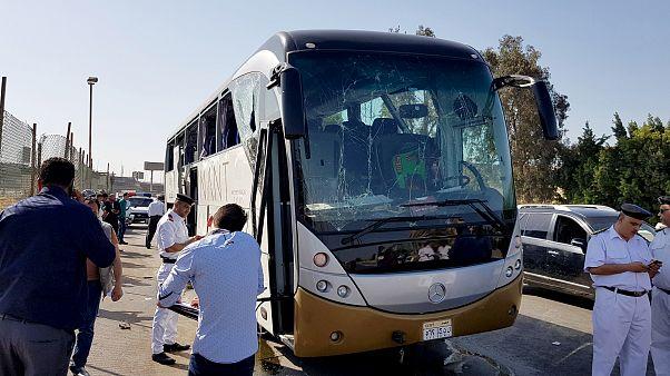 Image: A damaged bus near the site of a blast near the Giza pyramids in Cai