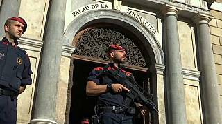 Catalan police seal off polling booths to block independence vote