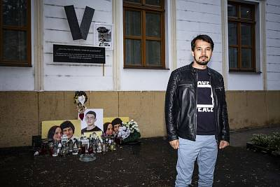 Juraj Šeliga stands next to a memorial for murdered journalist Jan Kuciak and his fiancee, Martina Kušnírová, in Bratislava.
