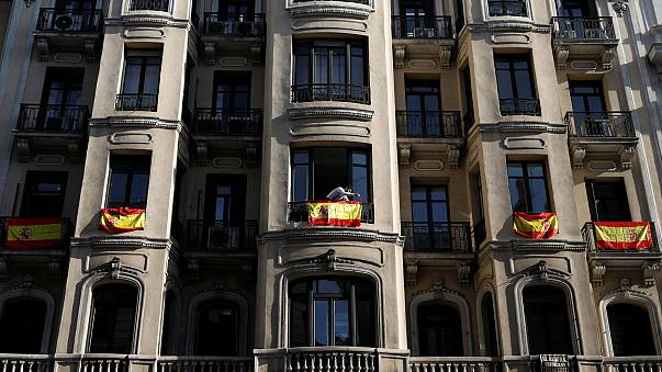 In Madrid the talk is of unity and the buildings draped with flags