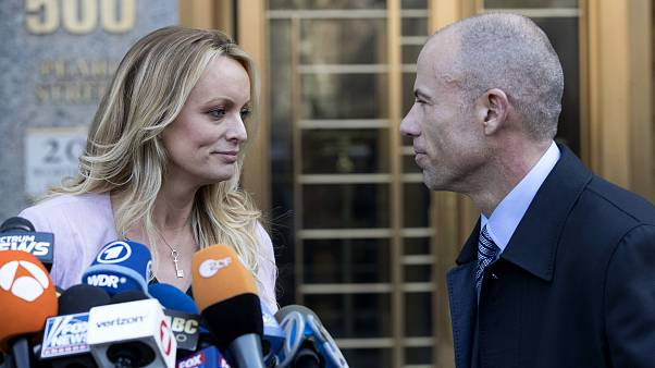 Image: Stormy Daniels looks her attorney, Michael Avenatti, after making a
