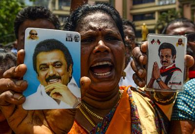 An Indian member of the Dravida Munnetra Kazhagam party (DMK) celebrates as results came in for India\'s general election in Chennai.