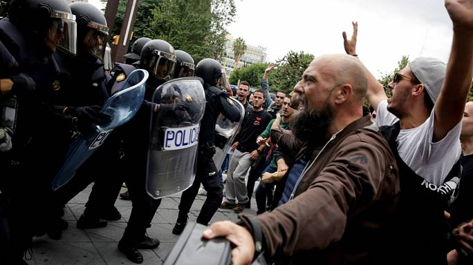 Hundreds hurt as police use force to stop Catalonia vote