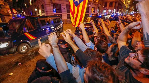 Protesters urge national police to leave Catalonia after crackdown