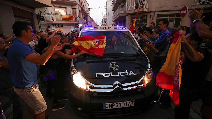 Pro-Spain protesters rally with police officers in Catalonia