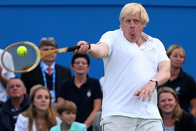 London Mayor Boris Johnson laughs in action during the Rally Against Cancer charity match on day seven of the AEGON Championships at Queens Club on June 16, 2013 in London, England.