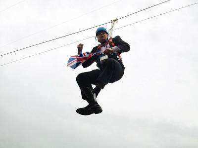 Former London Mayor Boris Johnson dangles from a zipwire in London's Victoria Park on Aug. 1, 2012 in London, England.