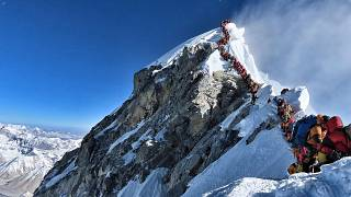 Image: Climbers line up near the summit of Mount Everest