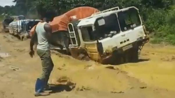 Watch: Aid trucks swarm across pools of mud