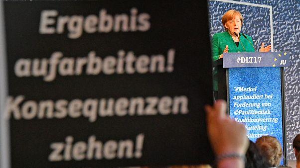 Merkel negoceia futura coligação