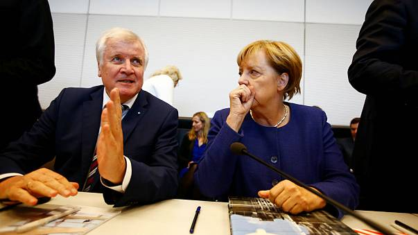 Merkel 'agrees' refugee cap with allies