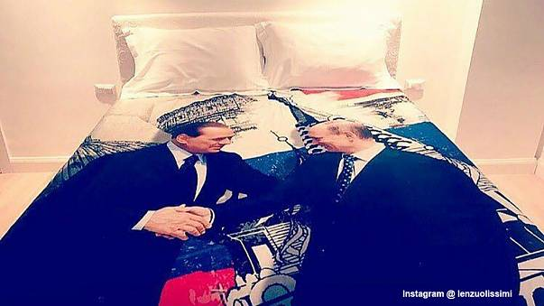 Berlusconi gives Putin a duvet cover for his 65th birthday