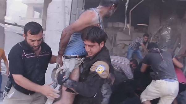 A man and boy were pulled from the rubble of a building after an airstrike in Idlib