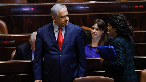 Image: Israeli Prime Minister Benjamin Netanyahu stands during a vote on a