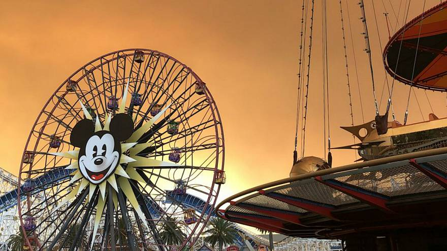 Orange ashy sky brings spooky feeling to Disneyland resort in California