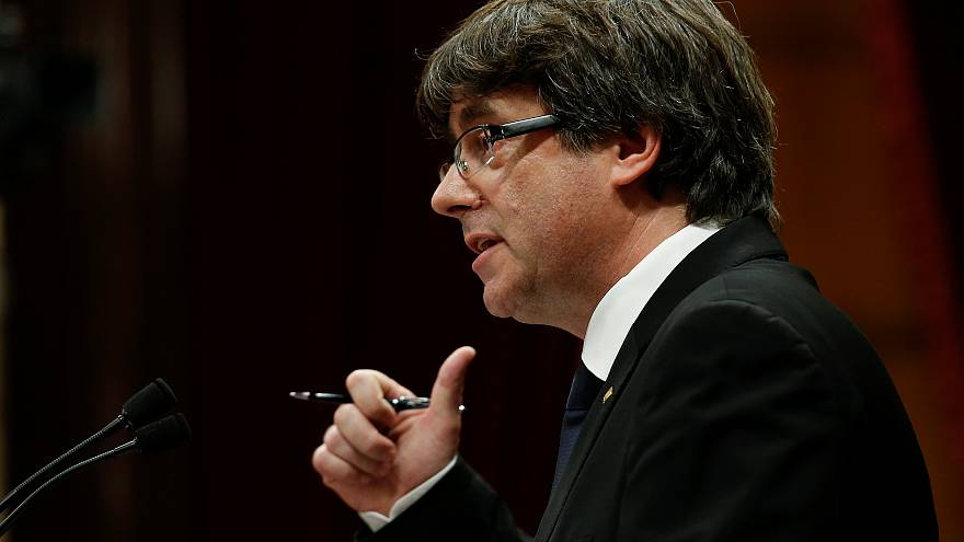 Catalan leader asks for mandate to declare independence but suspends it for dialogue, says worth exploring international mediation