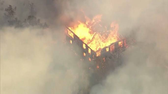 Scores unaccounted for as California wildfires rage on