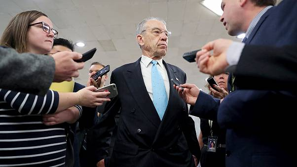 Image: U.S. Senator Grassley speaks to reporters on his way from the Senate