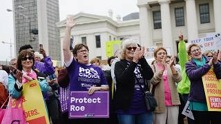 Image: Women cheer during a protest rally over recent restrictive abortion