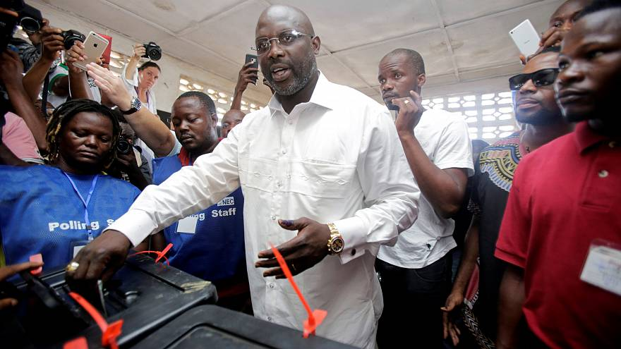 Ex-football star George Weah ahead in Liberia election