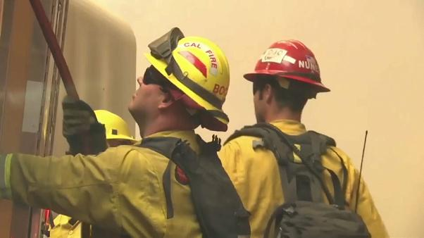 Firefighters continue to battle California wildfires