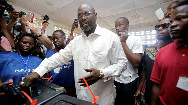 Liberian elections: Former footballer George Weah leads in provisional first-round results