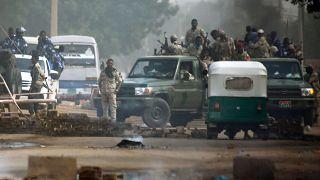 Image: Sudanese forces are deployed around Khartoum's army headquarters on