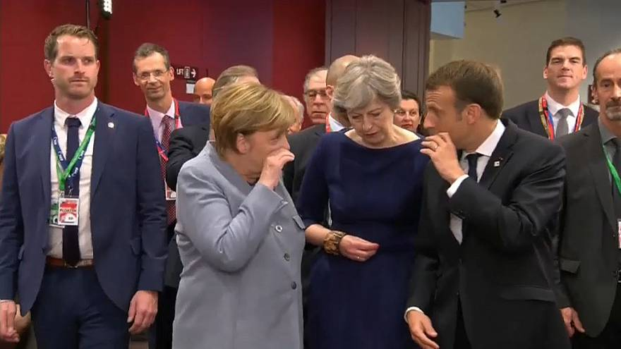Body-language expert on Macron, Merkel and May's hushed EU Summit conversation