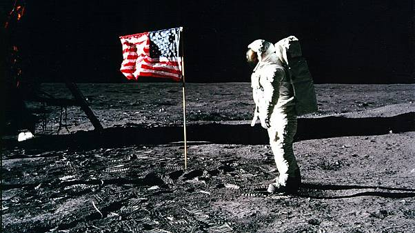 Image: Astronaut Buzz Aldrin salutes the American flag on the surface of th
