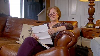 """Janet Uhlar, a former juror on the James """"Whitey"""" Bulger trial, reads a letter that the Boston gangster sent her from prison."""