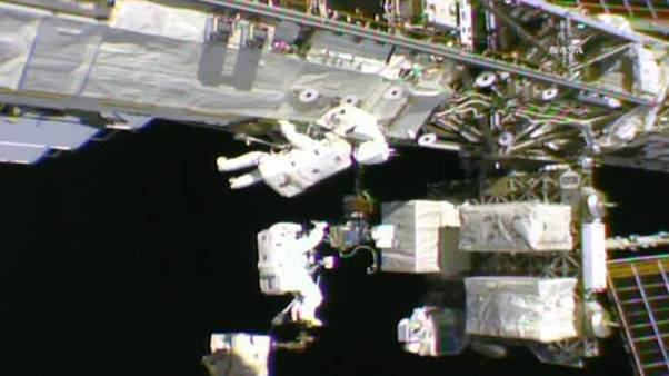 Live: Astronauts look down on the earth from the ISS during a spacewalk