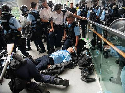 An injured Police officer lies on the floor during a protest against a proposed extradition law on June 12, 2019 in Hong Kong.