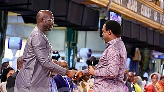 Weah visits top Nigerian televangelist ahead of Liberia runoff