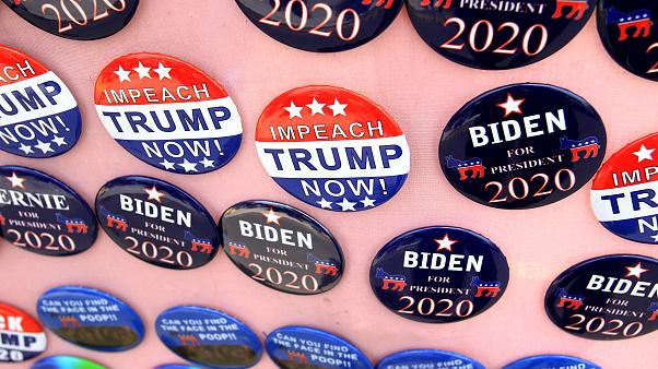 Image: FILE PHOTO: Biden for President campaign buttons and Impeach Trump N