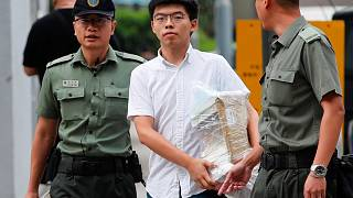 Image: Former student leader Joshua Wong walks out from prison after being