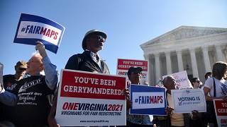 Image: Demonstrators gather outside the Supreme Court during oral arguments