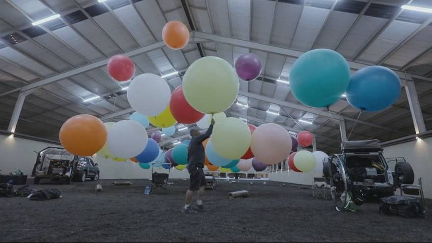 Man flies over South Africa using balloons and a camping chair