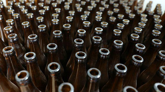 Beer today… truck smash leaves 30,000 bottles strewn across road