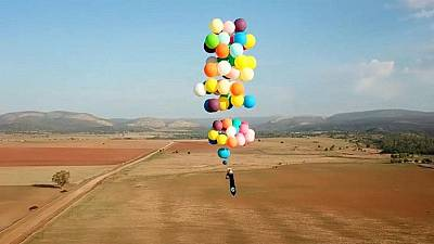 Man flies over South Africa in a chair tied to helium balloons