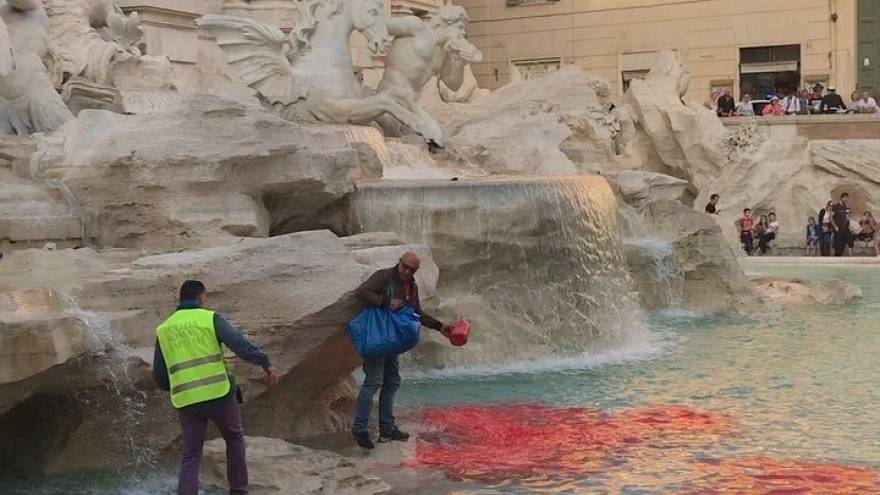 Rome's Trevi Fountain turns red after protester dumps dye into it.