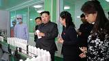 Rare public outing for Kim's wife on factory tour