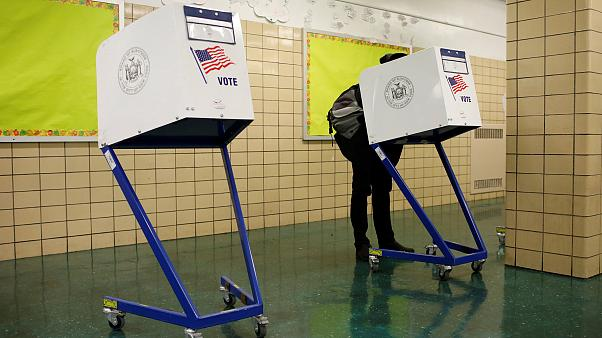 Image: Person votes during the midterm election at P.S. 140 in Manhattan, N