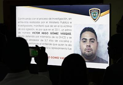 Journalists take pictures of a projection of a man identified by authorities as Victor Hugo Gomez Vasquez, a suspected intellectual author of the attack against former Boston Red Sox slugger David Ortiz in Santo Domingo, Dominican Republic, on June 19, 2019.